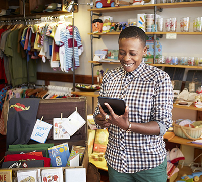 A female shop owner with her tablet