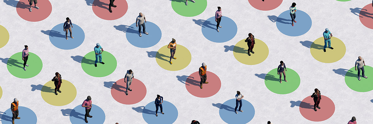 A group of people standing in multi-colored socially distanced circles