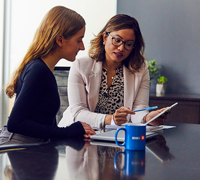 Two women meeting in a boardroom