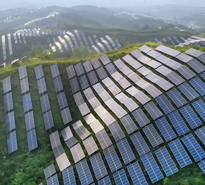Rows of solar panels along the hills