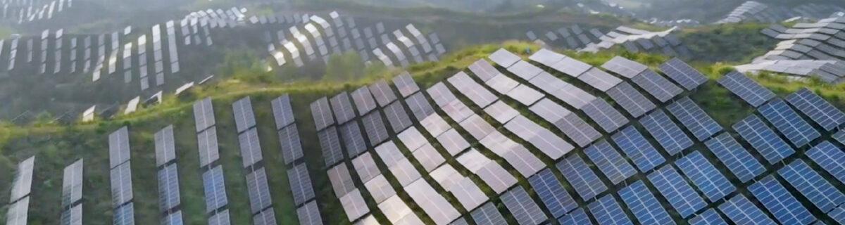 Solar panels in a green field