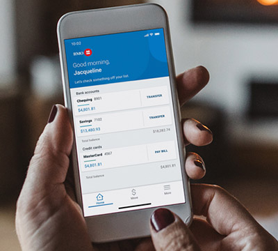 Hand holding mobile with BMO's mobile banking app