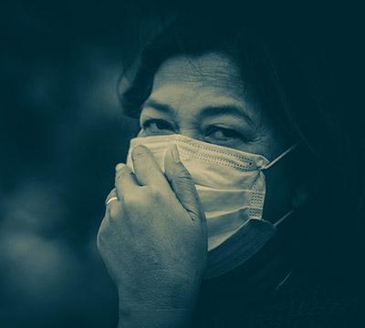 A lady wearing a mask